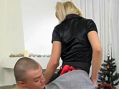 Pigtailed golden-haired sweetie strokes and sucks a giant cock